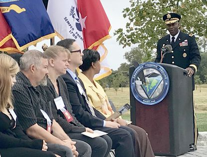 Maj. Gen. Mitchell L. Kilgo, senior commander of Aberdeen Proving Ground, speaks during Gold Star Mothers' and Families' Day in the APG Gold Star Plaza and Living Legacy Forest on Sunday. Officials at the Army post honored 29 fallen service members and their families during the event.