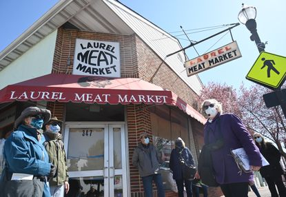 Tour guide Karen Lubieniecki, right, teaches participants about the historic Laurel Meat Market building during Laurel Historical Society's walking tour on Saturday, March 20, 2021.