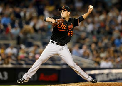T.J. McFarland of the Orioles delivers a pitch in the fifth inning against the New York Yankees on May 8, 2015 at Yankee Stadium.