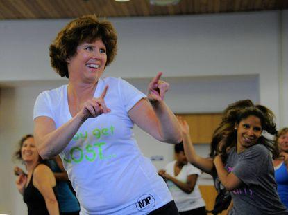 Jan Keadle dances with the group during the Maverick Dance Party.