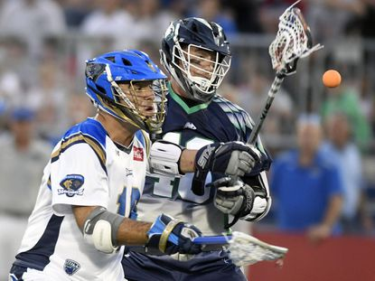 Chesapeake Bayhawks attackman Matt Danowski, right, and Charlotte Hounds defenseman Robert Duvnjak vie for a loose ball in the first half of Major League Lacrosse game at Navy-Marine Corps Memorial Stadium in Annapolis Friday, June 16, 2017. (Photo by Steve Ruark for Capital Gazette)