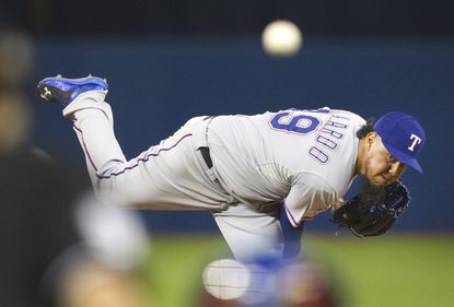 Texas Rangers starter Yovani Gallardo throws against the Toronto Blue Jays in the first inning of Game 1 of the American League Division Series in Toronto on Thursday, Oct. 8, 2015.