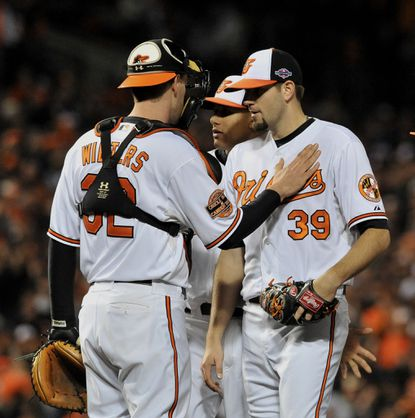 Orioles Matt Wieters pats the chest of starting pitcher Jason Hammel after he was taken out of Game 1 of the ALDS.