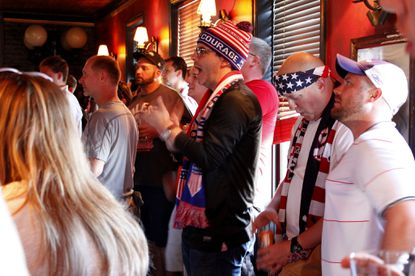 Lee Douthitt of Baltimore (center) and other soccer fans watch the U.S. men's national team's final tuneup before the World Cup from Slainte Irish Pub in Fells Point on Saturday.