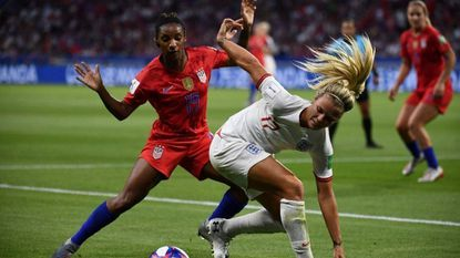 England's defender Demi Stokes (R) dives for the ball against United States' defender Crystal Dunn during the 2019 Women's World Cup semifinal, on July 2, 2019, at the Lyon Stadium.