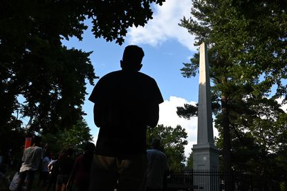 "People gathered last month for ""West Wednesday"" near the Columbus Obelisk. Tawanda Jones led the 361st consecutive meeting as they continued to call for justice for her brother, Tyrone West, who died in police custody in 2013. Baltimore City Councilman Ryan Dorsey has proposed renaming the statue the ""Victims of Police Violence Monument."""