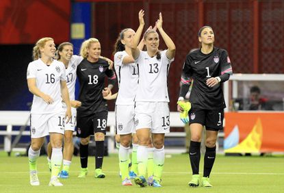 MONTREAL, QC - JUNE 30: Alex Morgan #13 and Hope Solo #1 of the United States celebrate the 2-0 victory against Germany in the FIFA Women's World Cup 2015 Semi-Final Match at Olympic Stadium on June 30, 2015 in Montreal, Canada. (Photo by Francois Laplante/FreestylePhoto/Getty Images) ** OUTS - ELSENT, FPG - OUTS * NM, PH, VA if sourced by CT, LA or MoD **