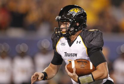 Sep 6, 2014; Morgantown, WV, USA; Towson Tigers quarterback Connor Frazier (4) scrambles for a first down against the West Virginia Mountaineers during the first quarter at Milan Puskar Stadium.