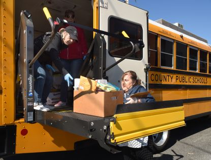 Trish Schoen, right, with Harford County Public Schools Health Services hands off a box of supplies to Denise Ajello with the schools Transportation Department to be placed on the bus as school system nurses drop off items from their schools' health suite Thursday afternoon at the school system's head quarters building in Bel Air. The donations were loaded onto the school bus and driven by Tina Hockaday to Upper Chesapeake Medical Center.