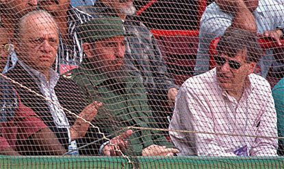 Baseball commissioner Bug Selig, right, and Orioles owner Peter Angelos, left, sit with Cuban dictator Fidel Castro while watching the Orioles play an exhibition game in Cuba.