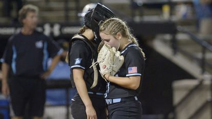 Westminster pitcher Emily Sicinski confers with catcher Olivia Herman during the sixth inning of the Owls' state championship game against Huntingtown in College Park Friday, May 25, 2018.