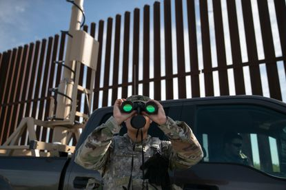 An active duty U.S. Army soldier scans for undocumented immigrants while on duty manning a high-res surveillance camera near the U.S.-Mexico border fence on September 10, 2019 in Penitas, Texas. (John Moore/Getty Images).