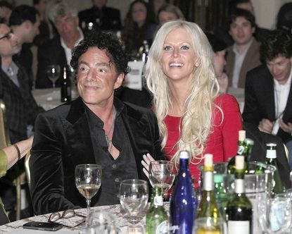 Michaele Salahi and boyfriend Neal Schon attend the 2011 Billboard Touring Awards at the Roosevelt Hotel in New York City.
