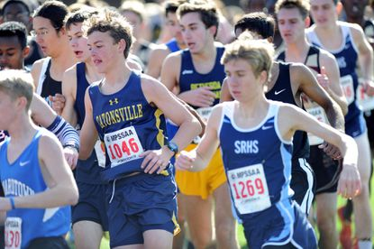 Catonsville's Graham Strzelecki is among those navigating a turn during the first part of Saturday's Class 4A boys state cross country meet.