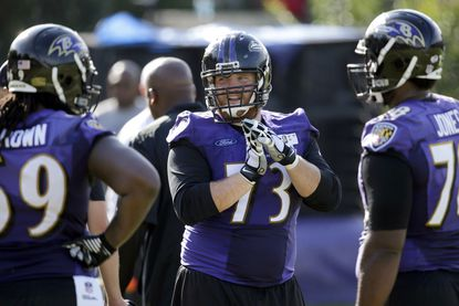 Ravens guard Marshal Yanda, center, speaks with teammates Leon Brown, left, and Marcel Jones during training camp in Owings Mills onAug. 5, 2015.