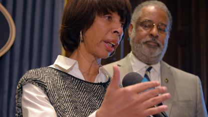 Mayor Catherine Pugh (with City Solicitor Andre Davis) resolved long disputed issues in a new contract approved this week by the Baltimore Fraternal Order of Police.