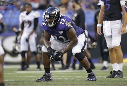 Ravens guard Kelechi Osemele lines up for a play during training camp. If Osemele can excel at left tackle in place of the injured Eugene Monroe over the next three weeks, the Ravens might have one fewer position to fill during a busy offseason.