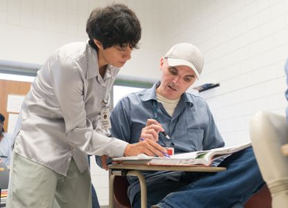 Goucher professor Citlali Miranda-Aldaco works with Goucher College student Shawn Vankirk, who is enrolled with Goucher College through the Goucher Prison Education Partnership and takes his courses at the Maryland Correctional Institution Jessup (MCIJ).