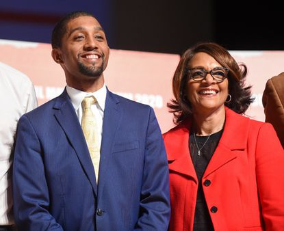Baltimore City Council President Brandon Scott and former Mayor Sheila Dixon pose for a photo following a Jan. 25, 2020, forum.