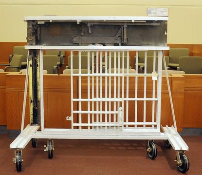 This is part of a cell door from the now closed Maryland House of Correction. It is one of several pieces of evidence from the death penalty trial of Lee Stephens, accused of murdering correctional officer David McGuinn at the now closed House of Correction. The items were photographed inside the Anne Arundel county courtroom where the trial is being held.