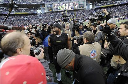 Middle linebacker Ray Lewis makes his way through media at the conclusion of the Baltimore Ravens' AFC wild-card playoff win against the Indianapolis Colts at M&T Bank Stadium in Baltimore Sunday.