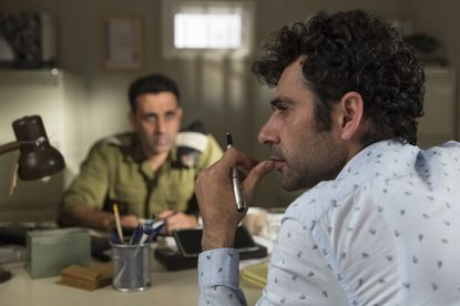 "Kais Nashif (foreground) and Yaniv Biton star in the comedy ""Tel Aviv on Fire."""