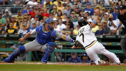 Tim Federowicz of the Los Angeles Dodgers tags out Alex Presley of the Pittsburgh Pirates during a game in 2013.