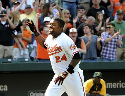 Wilson Betemit smiles as he heads for home plate after hitting a three-run, walk-off homer. The home run capped a five-run rally in the ninth inning that gave the Orioles a 5-2 win over the A's at Camden Yards.