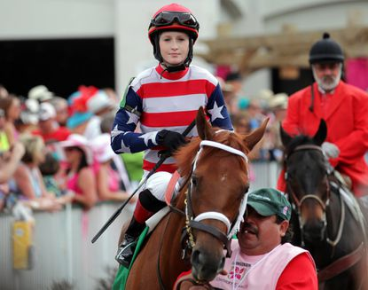 Rosie Napravnik sits atop Seaneen Girl prior to the running of the Kentucky Oaks on Friday.
