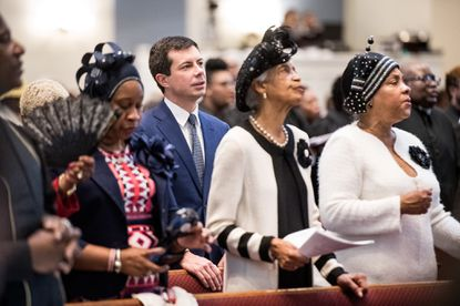 Democratic presidential candidate Pete Buttigieg listens to the Sunday church service at the Kenneth Moore Transformation Center on Oct. 27, 2019 in Rock Hill, South Carolina.