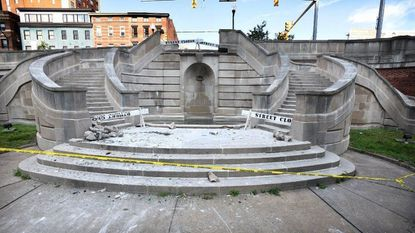 Car flips over, lands in fountain of newly redeveloped Preston Gardens park in downtown Baltimore