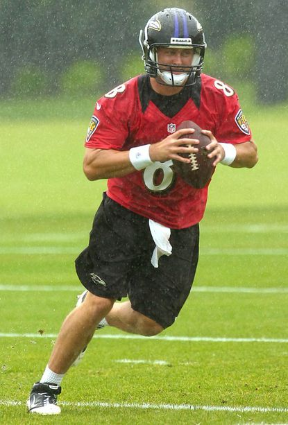 Ravens quarterback Curtis Painter works out during the team's minicamp in June in Owings Mills.