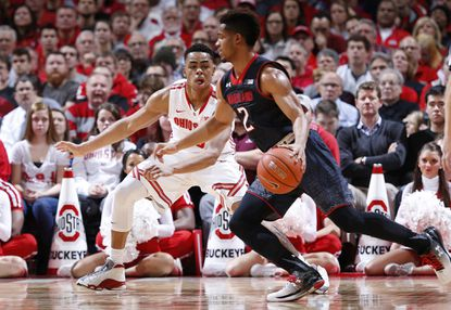 Maryland's Melo Trimble works off the dribble against Ohio State's D'Angelo Russell in the first half.