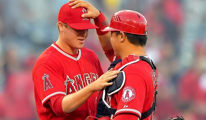 Angels relief pitcher Mike Morin and catcher Hank Conger celebrate after a 7-1 victory over the Cleveland Indians two weeks ago.