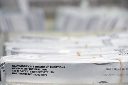 Maryland officials are looking at new vendors to potentially print and mail ballots for the November election after having several issues during the primary with the company they used to handle sending out ballots. In this June 6, 2020, photo, the Baltimore City Board of Elections counted ballots from the June 2 primary.
