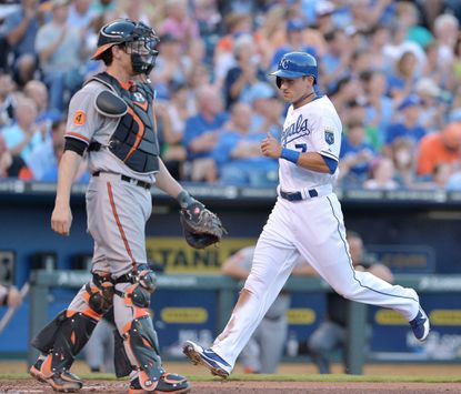 David Lough scores against the Orioles in a game at Kauffman Stadium on July 23, 2013.