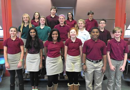 The McDonogh Singers are pictured in the choir room at McDonogh School, in Owings Mills, Nov. 23. Pictured from left, front row: Emory Lewis, Laya Neelakandan, Maya Ransome, Sarah Talbert, Carson Young and Delaney Norman. From left, middle row: Caroline Burke, Meggie Lee, Jennifer Workman, Emma Ryan and Jacob Rose. From left, back row: Katie Macejik, Daniel Kim, Kayla Thanner and Josh Mendelsohn. __- Original Credit: Elizabeth Irvine/submitted photo