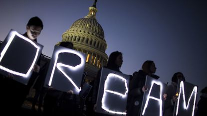 Demonstrators hold illuminated signs during a rally supporting the Deferred Action for Childhood Arrivals program outside the U.S. Capitol building in Washington on Jan. 18.