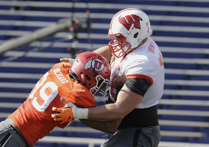 Wisconsin offensive lineman Rob Havenstein (right)works out during apractice for the Senior Bowl.