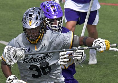 UMBC Retrievers attacker Mike Doughty (38) eludes Albany Great Danes midfielder Peter Salit during the fourth quarter of the America East tournament semifinal at Retriever Stadium Thu., May 6, 2021. The Great Danes stopped the Retrievers, 14-12. (Karl Merton Ferron/Baltimore Sun Staff)