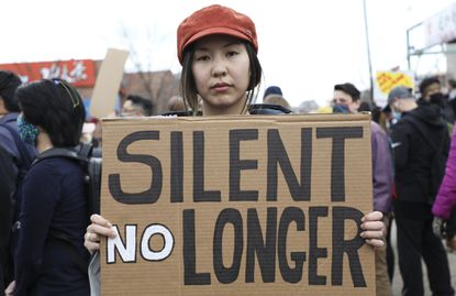 Jessie Chen, of San Francisco, and first-year medical student at Loyola University Chicago attends the Stop Asian Hate rally, at Chinatown'sSquare, Saturday, March 27, 2021. Abel Uribe/Chicago Tribune
