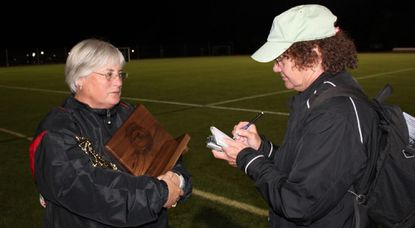 Carol Gralia, right, interviews Glenelg field hockey coach Ginger Kincaid after the 2010 2A state championship game, which the Gladiators won 2-1 over Century for the first state title in program history.