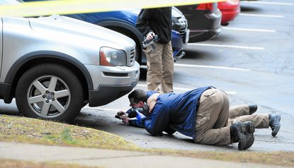 Crime Scene Investigators with the Harford County Sheriff's Office gathered evidence following Tuesday's fatal shooting of a 28-year-old woman in the Calvert's Walk community in Bel Air South.