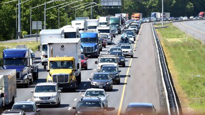 Traffic backs up on I-95 Northbound around the scene of a bus crash on I-95 at exit 89 Monday morning.