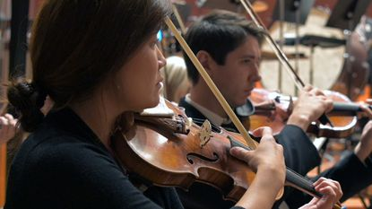 Baltimore Symphony Orchestra musicians perform during a free concert at New Shiloh Baptist Church on Sept. 14. A new contract could mean their return to the Joseph Meyerhoff Symphony Hall this Friday.
