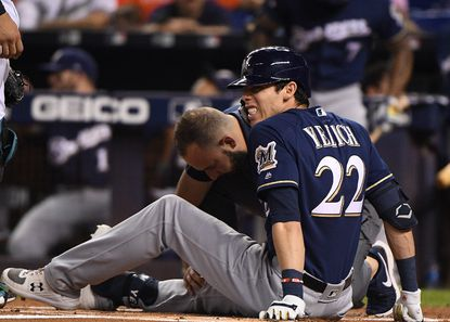 Christian Yelich of the Brewers is checked out by the medical staff after an injury from ball deflection in the first inning against the Marlins on Sept. 10, 2019 in Miami.