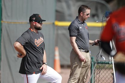 Chris Holt, left, was named the Orioles pitching coach for the 2021 season and will continue his role as the organization's director of pitching.