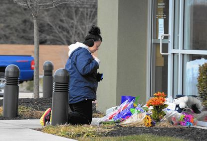 The makeshift memorial outside the Abingdon Panera Bread restaurant where people left flowers and notes of condolences to pay respect to the two Harford County Sheriff deputies killed Wednesday.