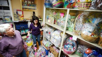 Barb Price of Winfield, left, and Ellen Nestorick of Finksburg were volunteering at Shepherd's Staff in Westminster in 2017 to assemble Easter baskets that will be distributed to families with children.