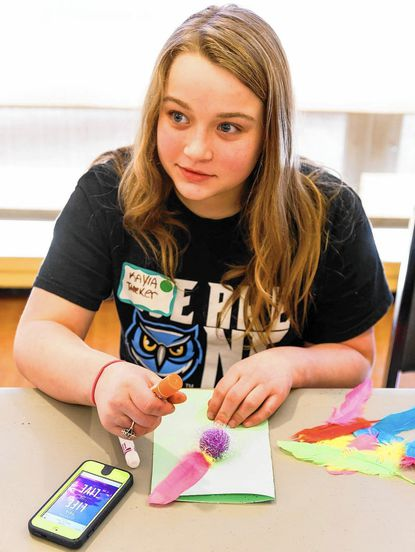 Carroll County Public Schools student Kayla Tucker makes a card for the Golden LivingCenter nursing home in Westminster during A Day On, Not a Day Off at McDaniel College Jan. 18. - Original Credit: McDaniel College/submitted photo